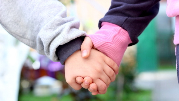 Two Kids Holding Hands preview image