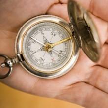 0531_hand-holding-compass_416x416-300x3001