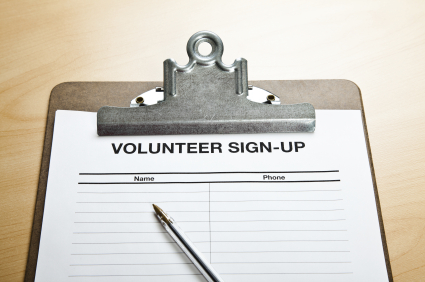 Blank volunteer sign-up sheet on a clipboard waiting for people to put their name and phone down to volunteer. With pen.