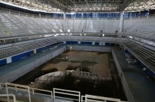 inside-the-aquatic-center-the-pool-is-drained-except-for-some-unpleasant-standing-water
