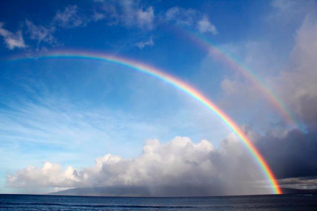 Double rainbow Pacific Ocean beach scene on Maui Hawaii
