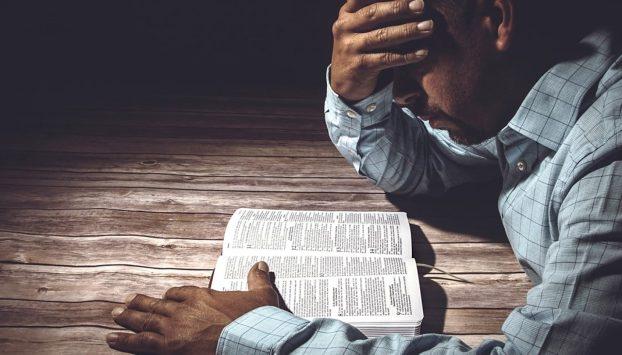 Man-reading-Bible-2100x1200